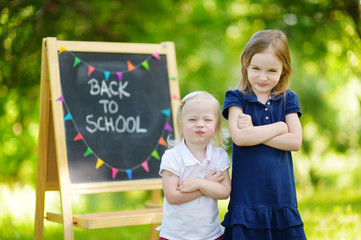 Two cute being unhappy about going to school