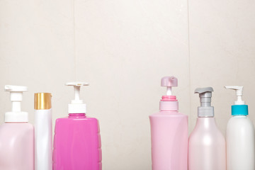 Different type of toiletry bottles in a bathroom