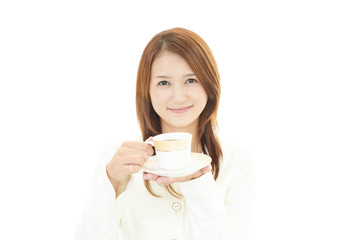 コーヒータイムを楽しむ女性
