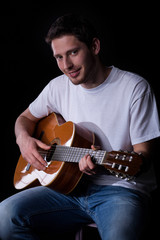Male guitarist with guitar