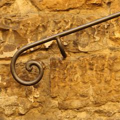 decorative  classic wrought handrail  on stone wall, Tuscany
