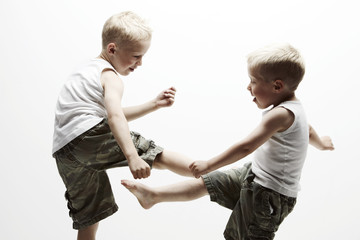 Portrait of two brothers fighting