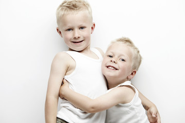 Portrait of two brothers hugging