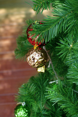 red and gold ornament on pine tree