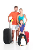 happy family standing with luggage on white background.