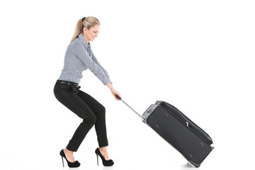 beautiful girl pulling big luggage.