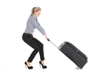 beautiful girl pulling big luggage.