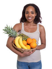 African woman with a basket of fruits