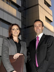 Executives close to the building and workplace.
