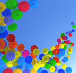 Colorful Umbrellas in Blue Sky