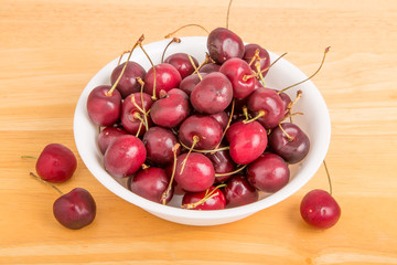 Bowl of Cherries with Three on Table