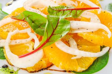 Orange salad with fennel and fresh herbs.Vegan food.