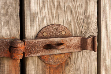 Old rustic barn door with latch