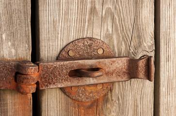 Old rustic barn door with latch