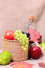 fruits, wine and autumn leaves