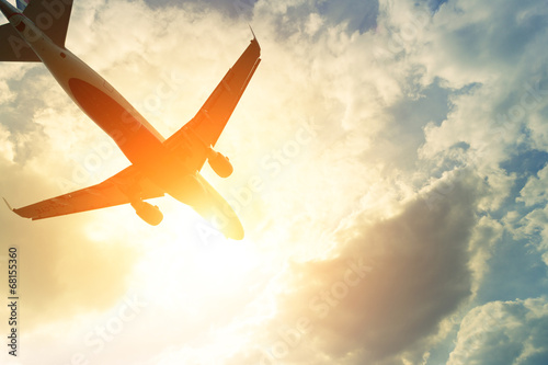 Toned photo of commercial airplane in the sun poster