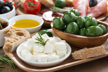 antipasti platter - fresh feta cheese, deli meats, olives