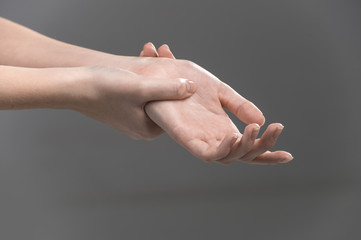 Woman holding her wrist - pain concept.