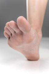 Women beautiful Foot stepping closeup.
