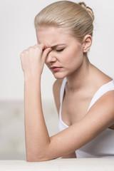 Close up portrait of woman feeling headache.
