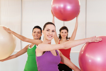 Group of women in pilates class at gym.