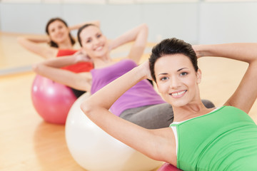 woman working out in gym doing pilates.