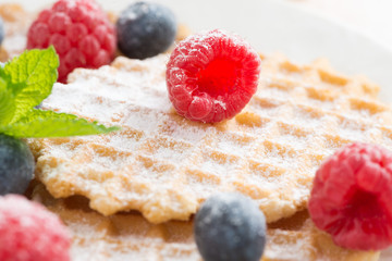 sweet Belgian waffles with fresh berries, selective focus