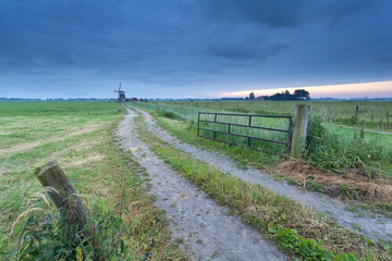 countryside ground road to windmill