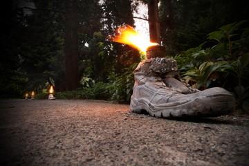 Öllampe in altem Schuh