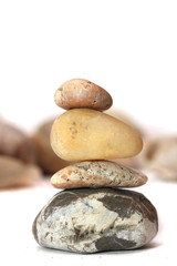 Hill of four stones on a background of pebbles