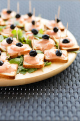 Closeup of snacks with salmon and black olives