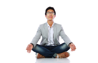 Man in casual cloth meditating over white background