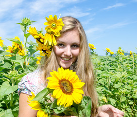 Happiness: Young pretty woman in sunflower field :)