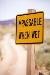 Impassable when wet Sign