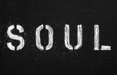 The word Soul in stencil letters on a blackboard