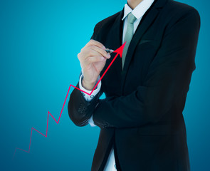 Businessman hand drawing a graph Isolated