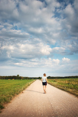 Woman walking on the country road
