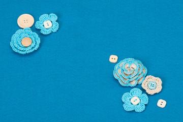 Handmade Crochet Flowers On Wool Felt Textile Background