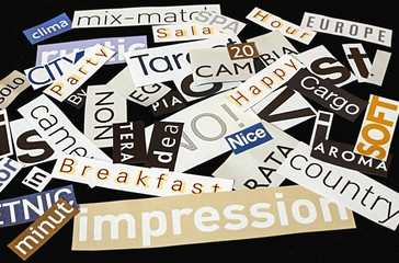 Words clipped from magazines on black background.