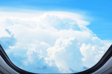 Aerial view of cloudscape from window of the airplane