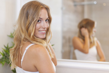 Portrait of beautiful blonde woman in bathroom