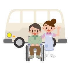 車椅子の男性と介護士