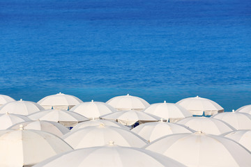 Tops of white parasols and sea Kathisma Lefkada Greece
