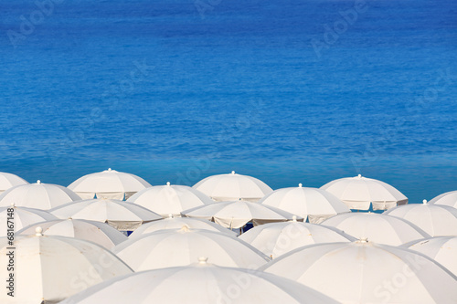 Tops of white parasols and sea Kathisma Lefkada Greece - 68167148