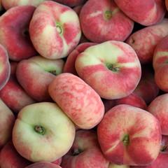 Saturn peaches, also known as Donut (Doughnut) peaches