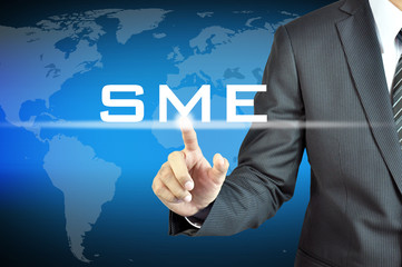 Businessman hand touching SME(or Small and Medium Enterprises)