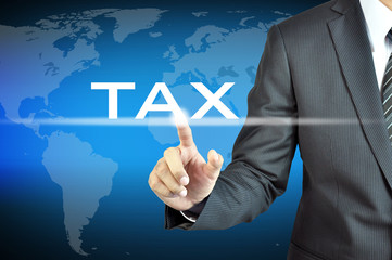 Businessman hand pointing on TAX word on virtual screen