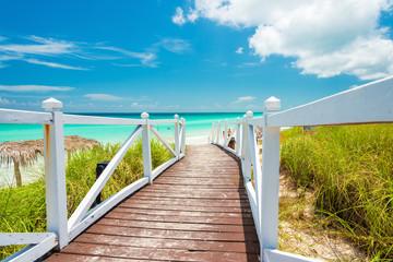 Walkway leading to a tropical beach in Cuba