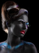 Body-painting. Woman with Fantastic Stagy Makeup over Black