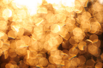 Glitter festive christmas lights background. light and gold defo